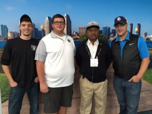 Laurel Parks and Recreation Director Elvin Ulmer pictured with members of the Oakland Raiders Grounds Crew, McCade Lynch, Dustin Pixton and Zachary Lougeuecker.